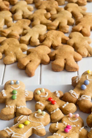 gingerbread: Decorated Gingerbread Men with Plain One in the Background