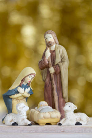 jesus mary joseph: Nativity Scene with Baby Jesus, Mary, Joseph, and Sheep on a Golden Background with Copy Space - Vertical Stock Photo
