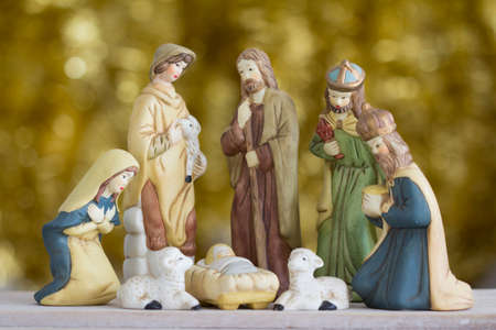 nativity background: Nativity Scene with Baby Jesus, Mary, Joseph, a Shepherd and a Wise Man on a Golden Background Stock Photo