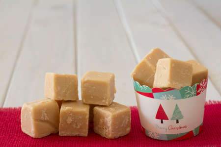A Cup of Caramel Fudge Christmas Gift with Stack on Side - Copy Space Horizontal