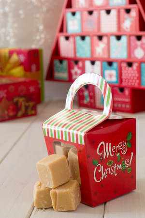 fudge: Christmas Caramel Fudge in Gift box on Table