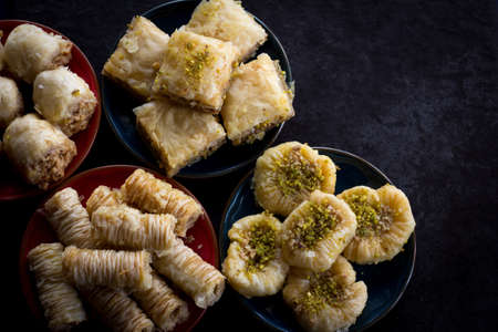 baklawa: Variety of Baklava on Dark Background From Above with Copy Space