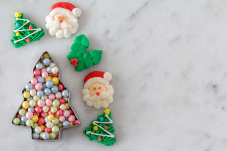 cookie cutter: Christmas Baking Decorations for Cookies with Cookie Cutter Full of Sugar Pearls from Above with Copy Space