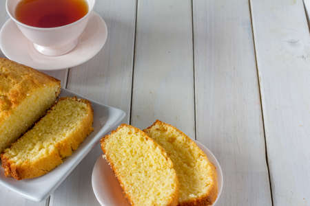 Madeira Cake from Above with Tea on a White Wooden Table with Copy Space Horizontal