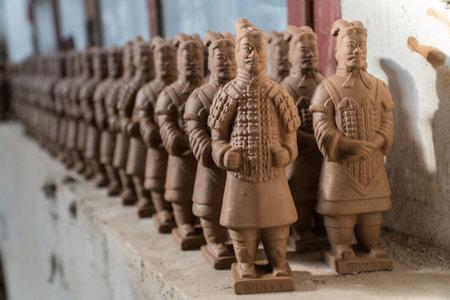 Terracotta Warrior Replicas on Shelf Drying in Factory in Xian China Editorial