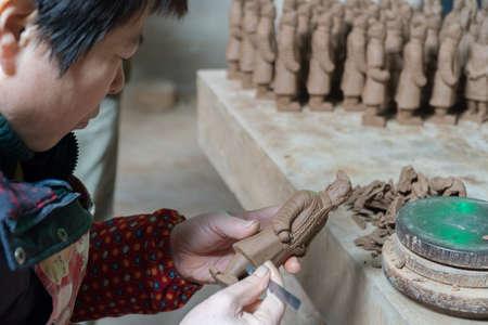 XIAN CHINA, NOV 20:  Chinese Worker Making Official Terracotta Warrior Replicas in Xian China, Nov 20 2017