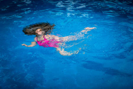 Pool Safety - Young Girl Drowning, Struggling to Swim Underwater in Pool