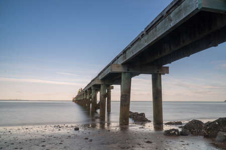 Long Exposure of Cornwallis Wharf in Auckland New Zealand on A Summer Evening