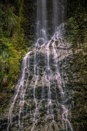 Close Up of Karekare Waterfall Auckland New Zealand - Vertical, Long Exposure