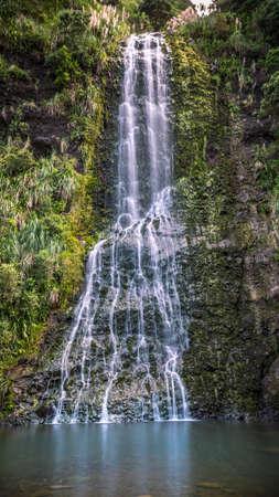 Long Exposure of Karekare Waterfall Auckland New Zealand - Vertical