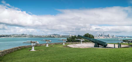 Historic Cannon on North Head Reserve Overlooking Auckland City Skyline on Bright Summers Day