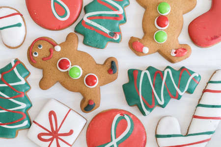 Close Up of Assortment of Christmas Gingerbread Cookies on White Wooden Background Reklamní fotografie