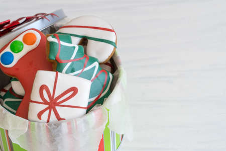 Close Up of Christmas Gingerbread Cookies in a Tin on Light Background, Copy Space Right