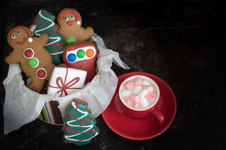 Tin of Christmas Gingerbread Cookies with Hot Chocolate and Marshmallows from Above with Copy Space
