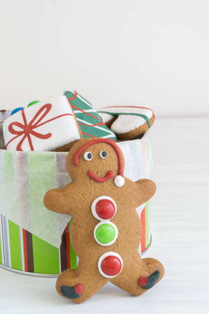 Front View of Tin of Christmas Gingerbread Cookies Vertical with Copy Space Top on Light Background
