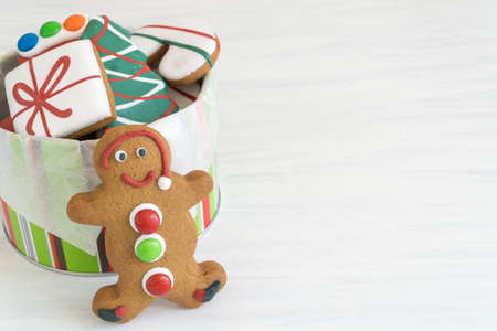 Front View of Tin of Christmas Gingerbread Cookies Horizontal with Copy Space Top on Light Background Reklamní fotografie