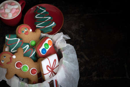Tin of Christmas Gingerbread Cookies with Hot Chocolate and Marshmallows from Above with Copy Space Right