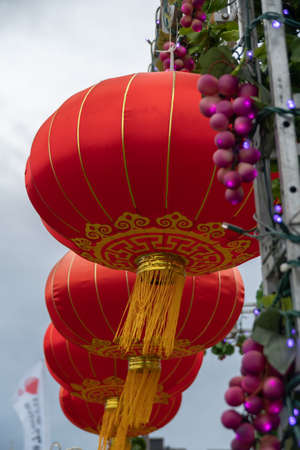 Close Up of Red Chinese Lanterns Hanging Outside Blowing In the Wind