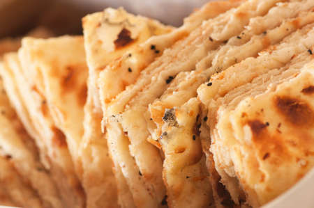 Closeup photo of indian bread with cumin. photo