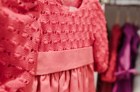 clothing store: A little girl dress hanging in a children clothing store. Stock Photo