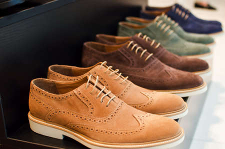 Shoes in a men fashion store.