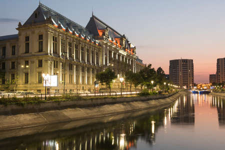 appeals: Bucharest, Romania  August 4, 2015: Dimbovita River and the Justice Palace in Unirii Square. Editorial