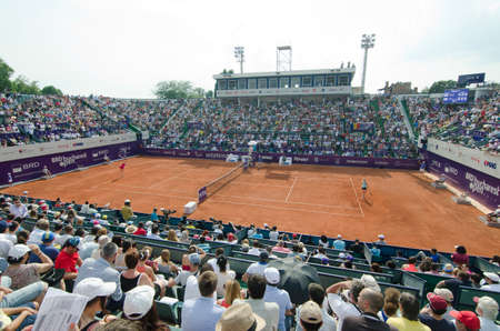 indy: Bucharest, Romania - July 9, 2014: Image from the central arena of BNR Arenas, during the tennis match between no.1 Romanian tennis player, Simona HalepRomania and Indy De VroomeNetherlands.