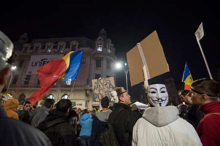 consecutive: Bucharest, Romania  November 4, 2015: For a second consecutive night, over 30.000 people gathered at the University Square in Bucharest and protest against the government and the corruption.