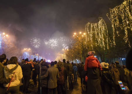 december 31: Bucharest, Romania – December 31, 2013: Fireworks on the New Years Eve, in Constitution Square, Bucharest.