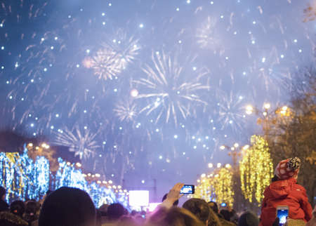 square: Bucharest, Romania – December 31, 2013: Fireworks on the New Years Eve, in Constitution Square, Bucharest.