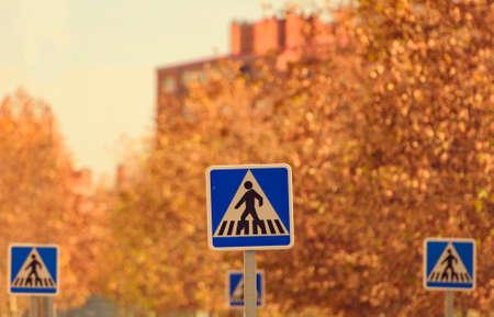 crosswalk: Crosswalk signs in urban area Stock Photo