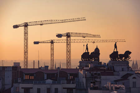 Madrid view at sunset, construction and old architecture in downtown.