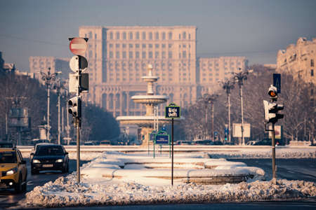 20 s: Bucharest, Romania – January 20, 2016: The Parliament Palace(People's Palace), the worlds largest civilian building during winter season.