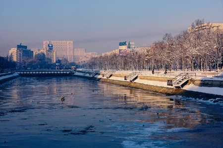 20 s: Bucharest, Romania – January 20, 2016: The Parliament Palace(People's Palace) and Dimbovita River, during winter season.