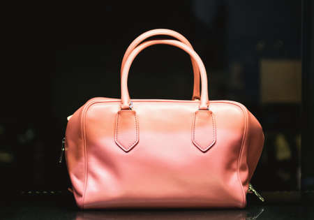 show case: Woman handbag in a showcase of a luxury store Stock Photo