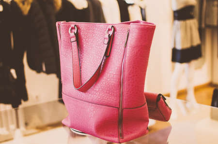 pink decorations: Pink women handbag in a clothing fashion store. Stock Photo
