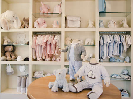 baby wardrobe: Children clothing store Stock Photo