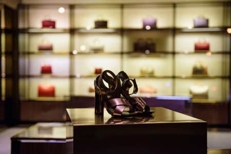 Shoes in a luxury fashion store. Stock Photo