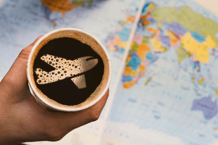 world thinking: Taking a coffee and thinking of traveling around the world.