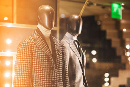 show window: Suit in a showcase of a luxury store Stock Photo