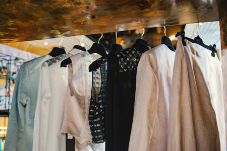 customer tailor: Clothes on racks in a fashion boutique