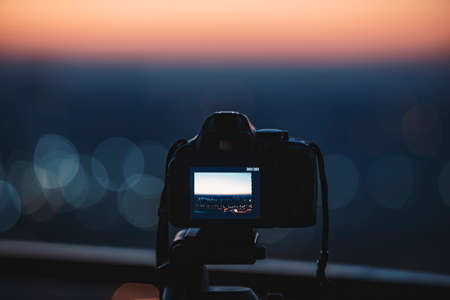 capturing: Digital camera on a tripod capturing the color of the city