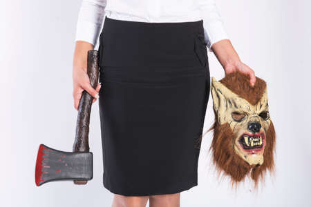 axe girl: Girl with a wolf mask and a bloody axe in business clothing Stock Photo