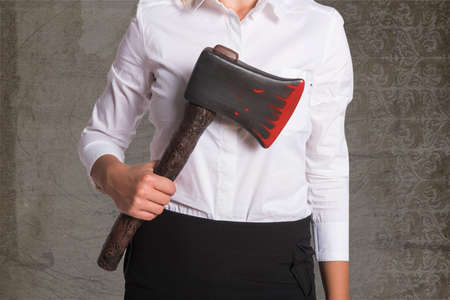 axe girl: Girl in a business clothing with a bloody axe