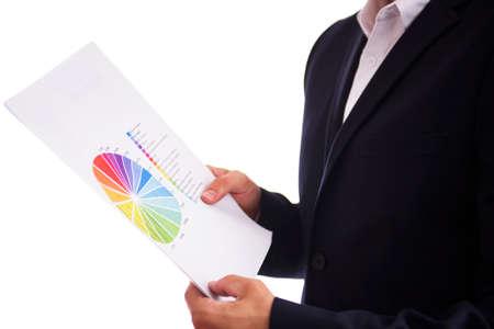 hoja de calculo: Hombre de negocios con informes comerciales Foto de archivo