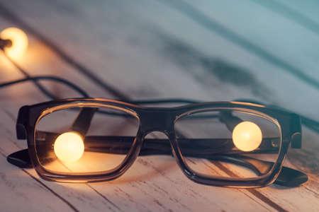 technology symbols metaphors: Eye glasses with lightbulbs