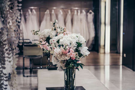 a frill: Luxury clothing shop with wedding dresses