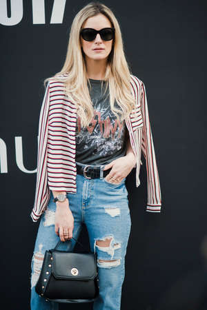 London, England – February 17, 2017: Beautiful model wearing an urban outfit, posing on the street during London Fashion Week.