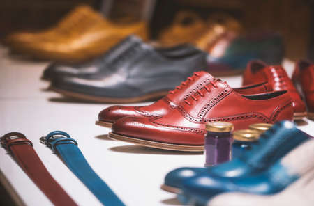 Fancy colorful shoes in a men clothing store.