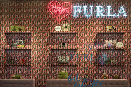 Paris, France - May 6, 2017: Furla handbags in a luxury store in Paris.